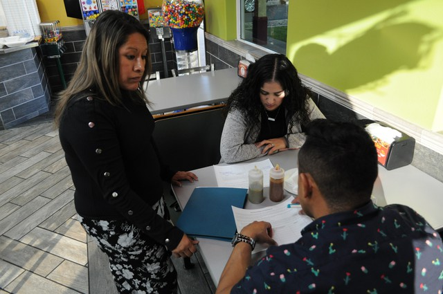 OneAmerica organizer Mary Lopez spent the hours leading up to the Nov. 19 Yakima City Council meeting speaking to residents like Manuel Ceja and Marta Herrera as they ate at a local Mexican restaurant.