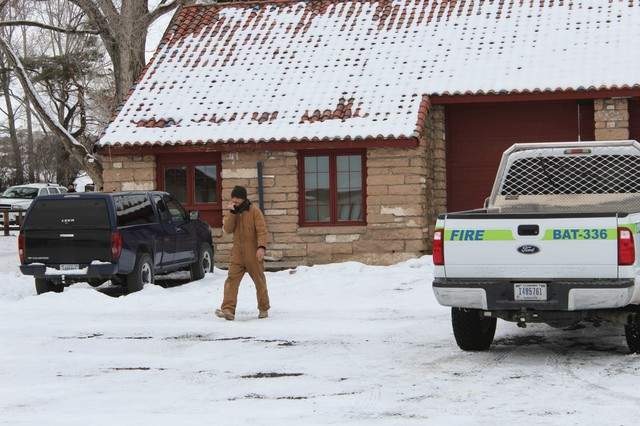 The unidentified militant seen here drove the federally-owned vehicle on the right while at the Malheur National Wildlife Refuge. He left the area after being photographed.