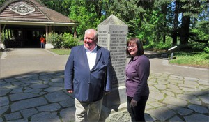 Greg and Rachel Leo pose beside the monument at the site of the historic vote at Champoeg, Oregon.