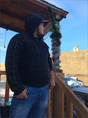 Luis Solorio glances toward the Rattlesnake Ridge landslide from his former home. Across the state there's a rental housing crunch--but that's especially true for farmworkers looking for affordable housing in Central Washington.