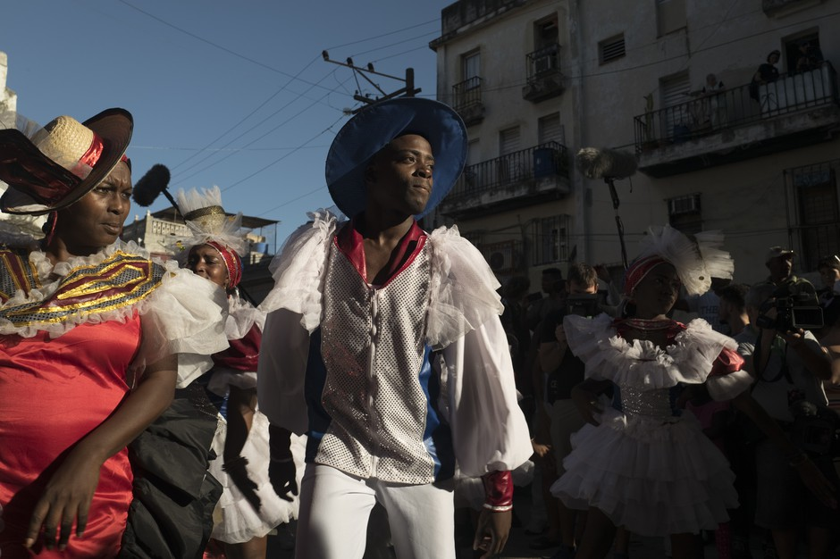 In the streets of Old Havana, Cuban dancers perform to a conga played by New Orleans musicians during a jazz festival.