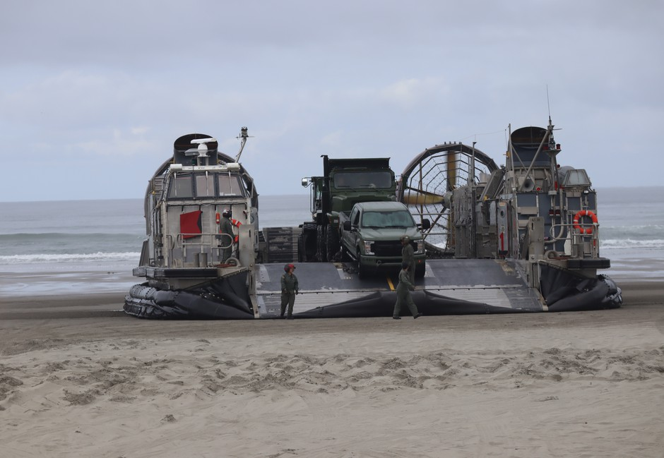 Navy hovercrafts deliver equipment, meant to clear roadways, during a mock Cascadia earthquake preparedness demonstration Monday.