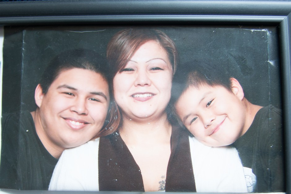In this photo, Shannon Jefferson poses with two of her six children.