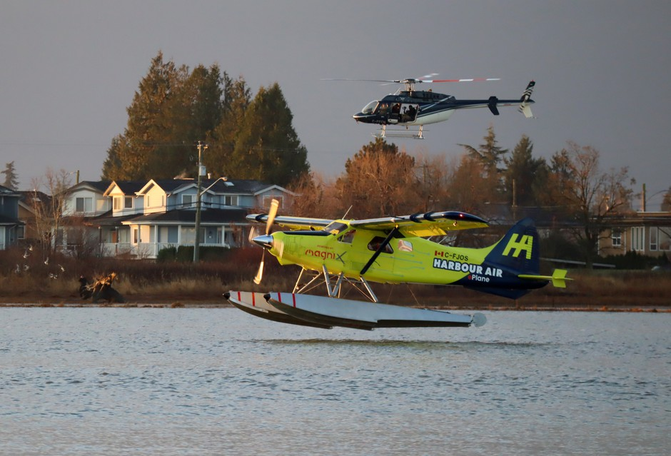 A de Havilland Beaver floatplane converted to electric battery-powered propulsion prepares to land on the Fraser River in Richmond, British Columbia.
