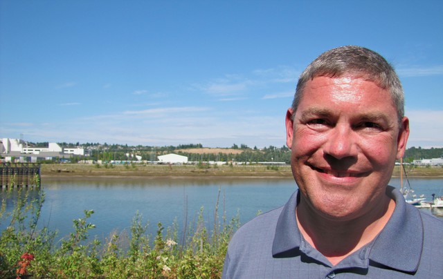 Shawn Blocker stands across the Duwamish River from the former site of Boeing Plant 2, which was demolished in 2010.