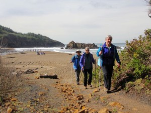 Connie Soper, front, and Dan and Lucy Hilburn are advocates for connecting the Oregon Coast Trail.