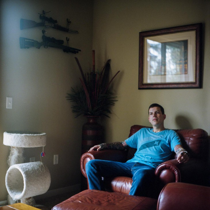 Josh Haggard sits for a portrait in his living room on Jan. 24, 2020, in Wilsonville, Ore. Haggard's mom, worried that her son might hurt himself, petitioned a judge to have his guns taken away using the state's new extreme risk protection orders but Haggard says the experience only worsened his mental health.