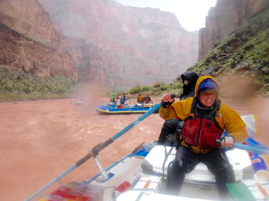 """Former """"Oregon Field Guide"""" photographer Nick Fisher rows down the Colorado River during a hail storm."""