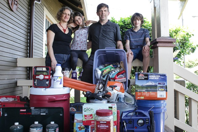 The Stephens, an Oregon family, outside their North Portland home with their emergency preparedness kit.