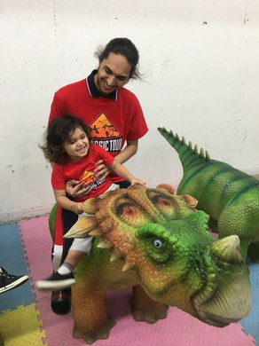 Uhusti Gause with his son, Uhusti Jr., who loves dinosaurs.