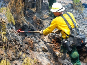Firefighters work to mop up hot spots within the Stouts Creek Wildfire.