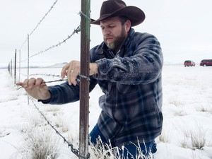 Ammon Bundy removes a fence separating the Malheur National Wildlife Refuge from ranching land.