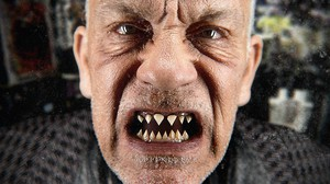 """The cover of John Malkovich's new album, """"Like a Puppet Show,"""" released on Record Store Day 2015"""