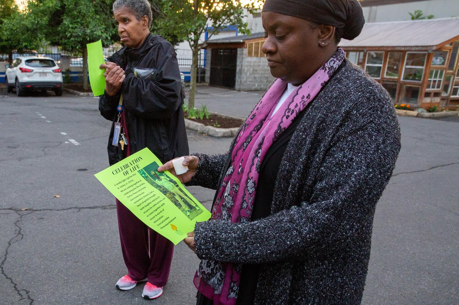 "Kenya Robinson holds a flyer of her son Otis ""TeTe"" Michael Gulley at his prayer vigil. Gulley was found hanging in Rocky Butte on Memorial Day. The medical examiner ruled it a suicide but police have opened an investigation into the death."