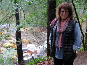 Dorie Vollum on the Wildwood Trail above construction for the expansion of Portland's Japanese Garden.