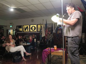 """Post Commander Sean Davis warms up the crowd at an October """"Slush Pile"""" reading."""