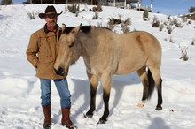 "Tom Sharp with his horse, ""Buck"" at his ranch outside of Burns."