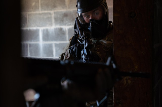 Pvt. Jeffrey Friberg with the Oregon National Guard's 741st Brigade Engineer Battalion clears a building on March 2, 2019 at Camp Rilea, Oregon.