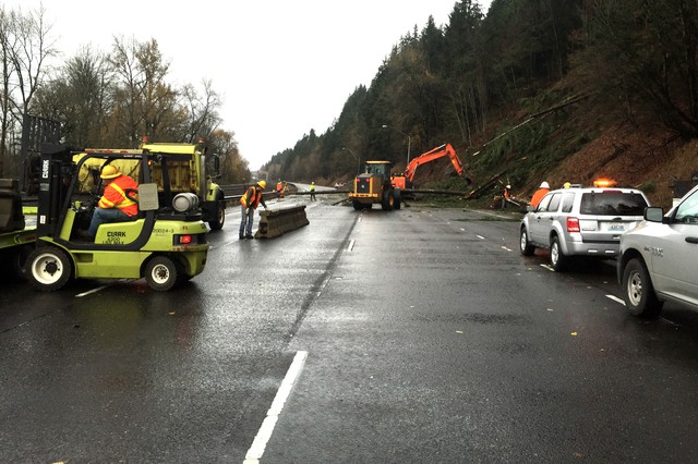 Crews work to clear debris and install temporary barriers to allow them to reopen one lane of Interstate 5 Dec. 10 after the entire northbound section of the highway was closed due to a Dec. 9 landslide. The interstate reopened two lanes the evening of Dec. 10.
