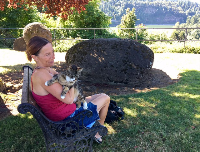 Robin Eckholt sits with her cat Chewy in the common area of her Milwaukie apartment.