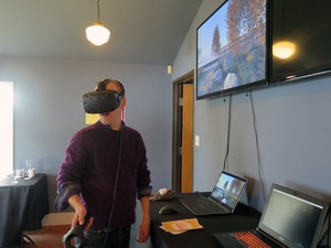 A supporter of Portland Playhouse tours the planned renovation with a VR visualization made by SERA Architects.
