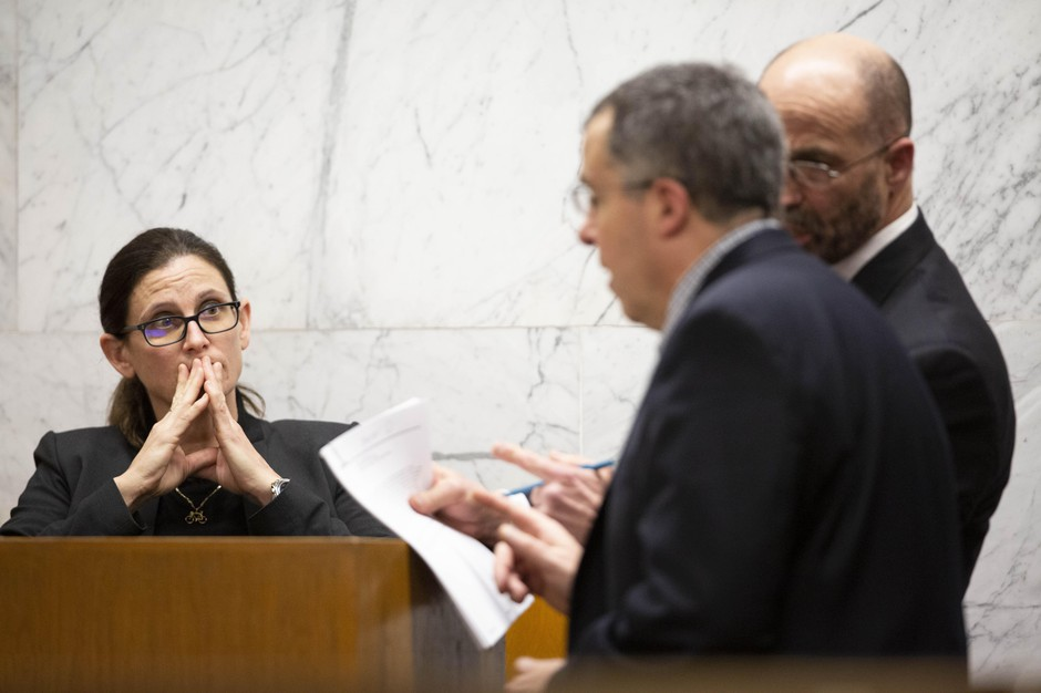 Defense attorney Dean Smith and prosecutor Jeff Howes discuss records shown to Portland police detective Michele Michaels during her testimony at the Multnomah County Courthouse on Feb. 13, 2020, day 11 in the trial of Jeremy Christian for the stabbing of three people on a MAX train in Portland in May 2017.