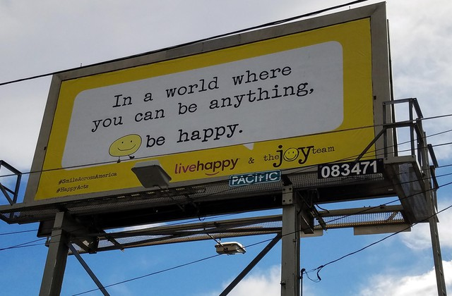 Pictured is one of a number of happiness billboards in Portland — and more than two dozen other U.S. cities — put up by The Joy Team, based in Vancouver, Washington.
