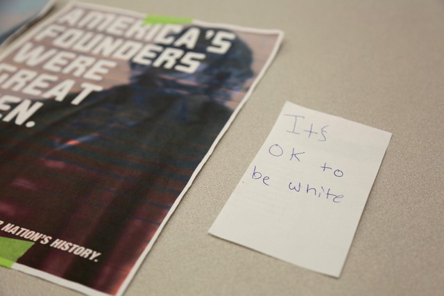 "File photo of posters reading ""It's OK To Be White,"" posted in the fall of 2017 around the campus of Clark College, a community college in Vancouver, Washington."