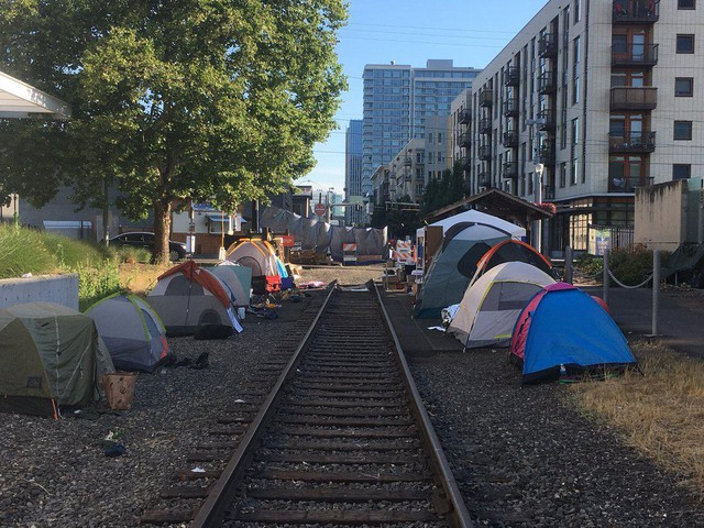 Tents line trolley tracks outside the ICE facility in Southwest Portland, Wednesday, June 20, 2018.