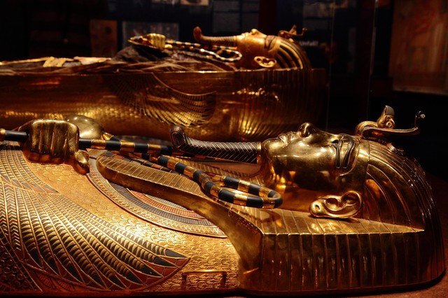 """Golden mummy cases are on display for the """"Discovery of King Tut"""" exhibit at the Oregon Museum of Science and Industry from October 2018 to January 2019."""