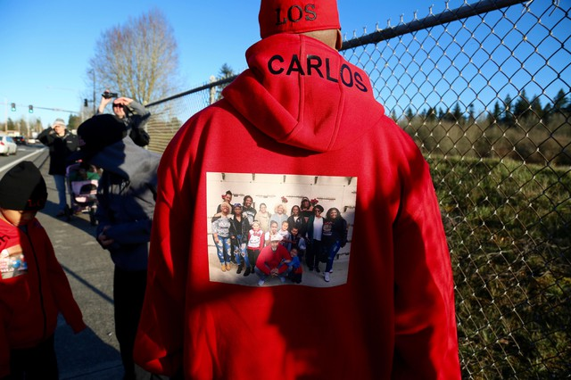 Many family and community members wore clothing with photos of Carlos Hunter to honor his memory.