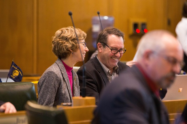 Rep. Paul Holvey, D-Eugene, (right) speaks with Rep. Nancy Nathanson, D-Eugene, in the House Chamber on April 30, 2019, in Salem, Ore.