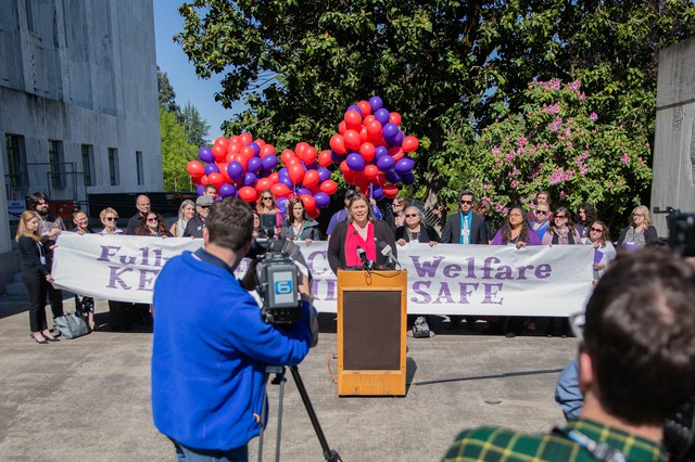 Melissa Unger, the executive director of SEIU Local 503, speaks during a rally forOregon Child Welfare caseworkers in Salem, Ore., April 30, 2019.