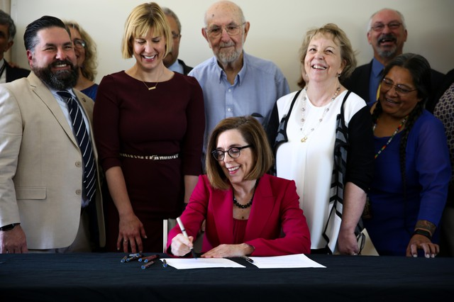 Gov. Kate Brown signs Senate Bill 1008into law at the June Key Delta Community Center in Portland, Ore., Monday, July 22, 2019. The law brings reform toOregon's juvenile justice system.