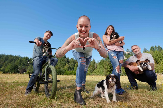 """Family portrait of Beast, Amanda, Jade and Gary with their dogs. Amanda Giese is the star of the new Animal Planet docu-show, """"Amanda to the Rescue."""""""