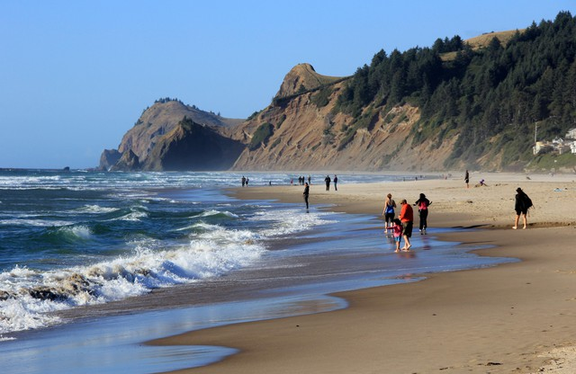 This May 2010 photo shows people on a stretch of beach in Lincoln City, Ore.