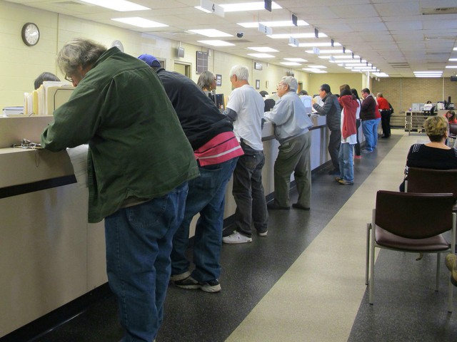Motorists visit a South Carolina Department of Motor Vehicles office in Columbia, S.C., on Feb. 27, 2014.