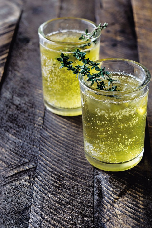 """Andrea Bemis suggests refrigerating the simple syrup for a bit before assembling these Bourbon Thyme Cocktails. """"For a more intense thyme flavor, a few sprigs can cool with the syrup for an additional 10 minutes."""""""