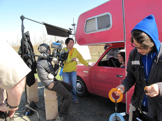 Shirlyn Wong (in yellow) directs Sydney Boyd, who plays a Las Vegas stripper with a pink RV.