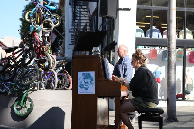 Piano! Push Play! founder Megan McGeorge plays a tune at the 13th and Burnside location.