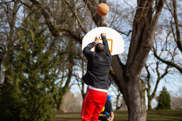 Mitchell Jackson plays a pickup game in Irving Park.