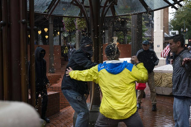 A Patriot Prayer marcher punches an antifa activist after the activist threw a soda at himduring a Patriot Prayer rallyon September 15, 2019 in Portland's Pioneer Square.