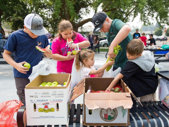 Zane Renfro, Sehven Trujillo, Aurora Trujillo, Logan Renfro and Danule Trujillo pick up free produce during Park & Play, a free summer lunch program in Klamath Falls, Oregon.