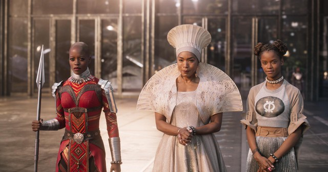 """Florence Kasumba (left), Angela Bassett (center) and Letitia Wright (right) in """"Black Panther,"""" featuring costumes designed by Ruth E. Carter."""