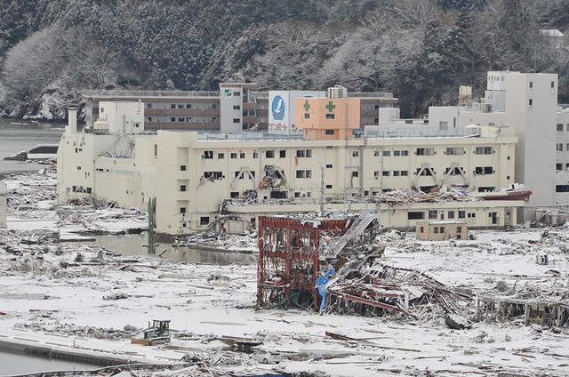 The disaster prevention center established by the Japanese town of Minamisanriku, red at center, was inundated by water when a tsunami swept the community March 11, 2011.