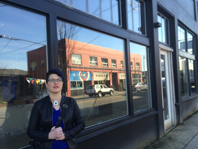 Katie Proctor stands in front of the storefront where Books With Pictures is slated to open in June.