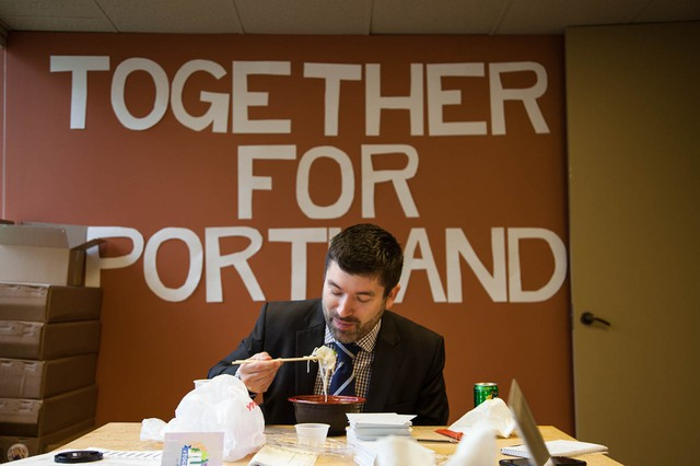 Multnomah County Commissioner and Portland mayoral candidate Jules Bailey eats lunch at his campaign headquarters.