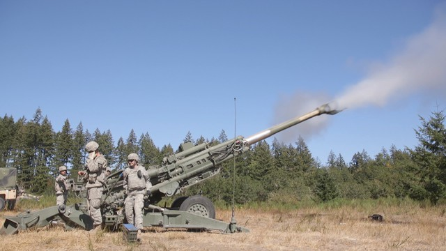 Soldiers at JBLM practice shooting a howitzer, which fires shells a distance of six miles