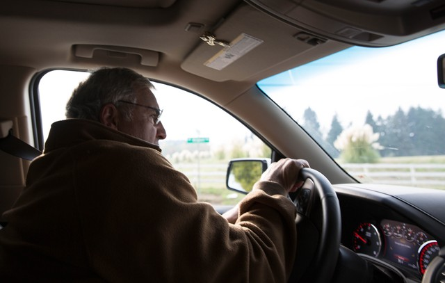 Chris Maletis, owner of Langdon Farms Golf Club, drives next to property he says would be well-suited for future industrial development.