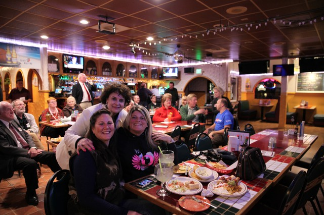 A jubilant crowd of Clackamas County Trump supporters cheers as results roll in at an Oregon City restaurant. Jo Havercamp (standing), Tammi Coehlo (right) and Cary Werthessen all voted for Donald Trump.
